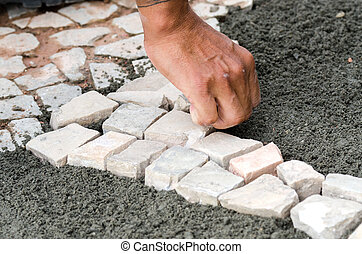 hand while building - hand worker while system stones of a...