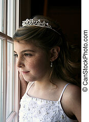 beautiful young girl in white beaded dress and tiarra -...