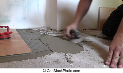 tiler working