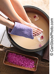 Relaxing foot bath, moment of relax - A woman washes the...