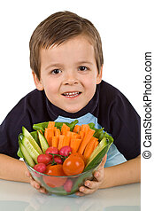 Healthy boy with vegetables - Healthy boy holding a bowl...