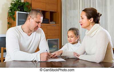 Sad family having financial problems - Poor family counting...