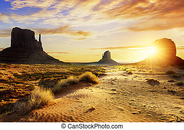Monument Valley - Sunrise at the sisters in Monument Valley,...