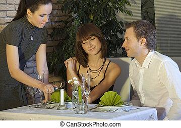 romantic dinner in restaurant - couple by romantic dinner in...