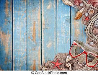 Beach concept - Beach sand, shells and seastar on blue...