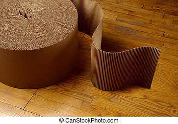 Moving day - Roll of corrugated packing material uncurling...