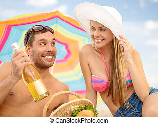 chappy ouple having picnic and sunbathing on beach - summer,...