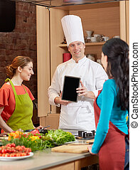 happy women with chef and tablet pc in kitchen - cooking...