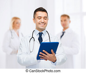 smiling male doctor with tablet pc at hospital - healthcare,...