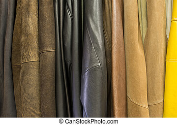 hanging a lot of leather jackets - hanging a lot of...