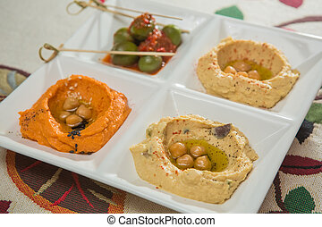 Delicious and healthy hummus set in white pate.