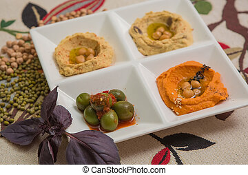 Delicious and healthy hummus set in white pate