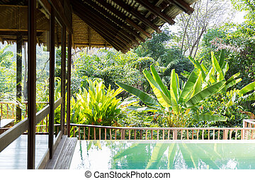 swimming pool and bungalow at hotel resort - leisure, travel...