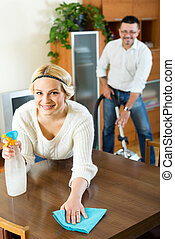 Family couple cleaning at home - family couple cleaning in...