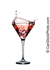 Red cocktail with splashes isolated on white