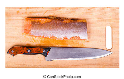 red fish fillet and knife