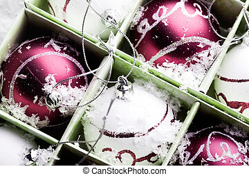Christmas ornaments - Red and white christmas ornaments in...