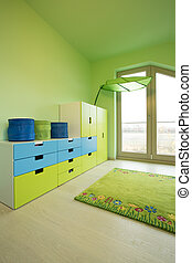 Colorful commode in big green children room