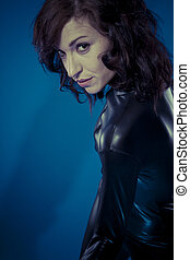Fetish, sexy brunette in black latex bodysuit tight and wild...
