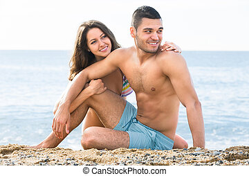 man and woman on the beach