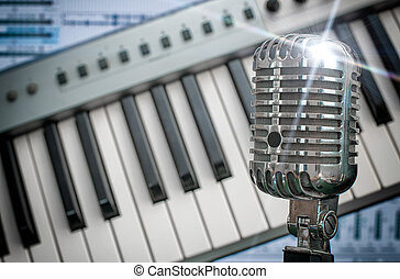 Retro microphone over piano and recording software...