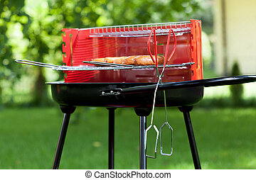 Sausages on charcoal grill - Horizontal view of sausages on...