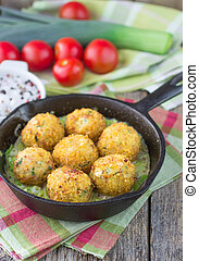 Fish cakes Soft focus - Homemade fish cakes with a sauce of...