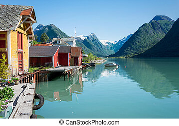 Fjord, mountains, boathouse and reflection in Norway - View...