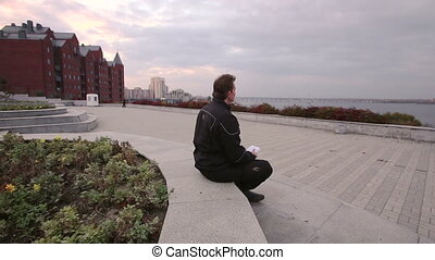 man sitting near the river