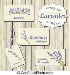 Lavender cards and labels on wood plank background. Template...