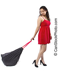 Trashbag - woman cleaning up and holding a black trashbag
