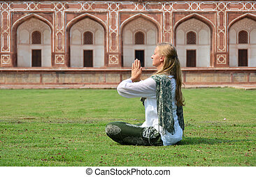 Young, woman, meditating, in, the, yard, of, Humayun's,...