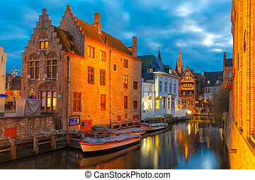 Cityscape with the picturesque night canal Dijver in Bruges...