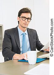Executive with glasses - Executive at the office wearing...