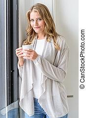 Beautiful woman having a coffee break - Beautiful woman...