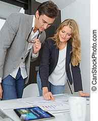 Business plan - Man and woman in casual business clothes...