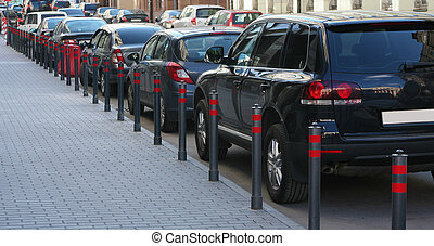 Parking on the street in the city - car parking on narrow...