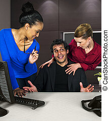 Office Sexual Harrassment - female employees in an office...