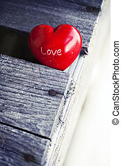red heart on wooden table background, love valentines day...