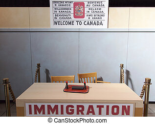 Welcome To Canada - Welcome to Canada sign and the table of...