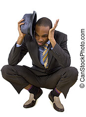 Businessman Ducking - young black businessman ducking from...