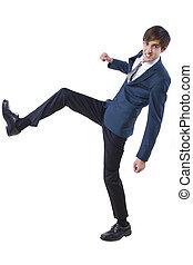 Businessman Kicking - young caucasian businessman kicking...