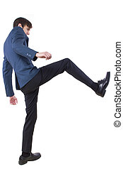 Businessman Kicking - young caucasian businessman kicking...