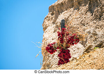 Flower Covered Cross - Cross covered in flowers inside of...