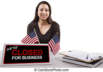 Government Shutdown - woman with a desk sign showing closed...
