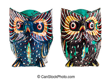 Wooden owls - two wooden owls isolated over a white...