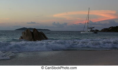 Waves at sunset on the beach of Anse Lazio.