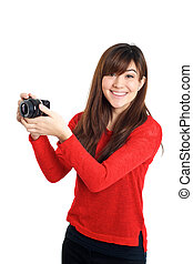 Asian girl taking photo with a compact camera looking at the...