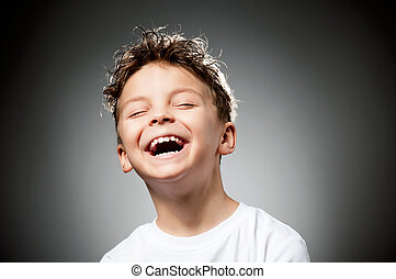 Emotional boy - Portrait of laughing boy on gray background