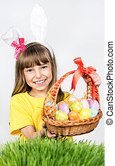 Easter holiday - Beautiful little girl dressed in bunny ears...